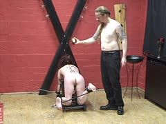 Redheaded German slave is tortured with wax