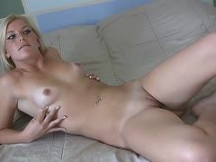 Blonde girl masturbates in front of the camera