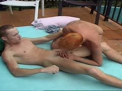 Red-haired granny sucks young dick