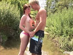Cute couple fucks outdoors at a walk