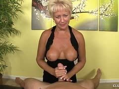 Smoking hot milf with big fake tits squeezes the cock