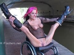 Red-haired nudist in wheelchair shows her slit outdoors
