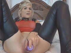 Milf in fetish outfit bangs her cunt and sucks