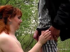 Fat red-haired granny has dirty sex in the forest