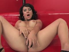 Black-haired is wearing her high heels during dildo sex