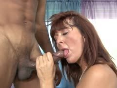 Redheaded housewife sucks the black cock