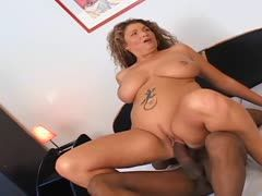 Chubby milf with huge tits does it with her black lover