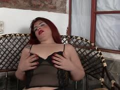 Chubby redheaded milf fucks herself with a dildo