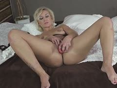 Blonde housewife plays with her wet twat