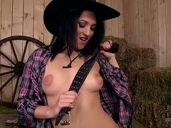 Sexy cowgirl strips and satisfies herself